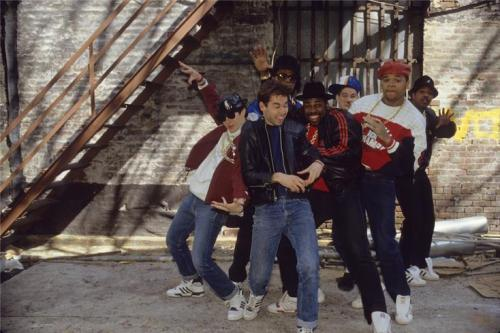 beastie boys run dmc in alley under fire escape brick wall